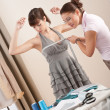 Stock Photo: Female fashion designer measuring model for fitting