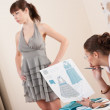 Stock Photo: Model fitting by female fashion designer
