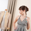 Fashion model trying gray dress in designer studio — Stock Photo #4698636