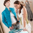 Fashion model trying jacket in designer studio — Stock Photo #4698643