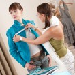 Female fashion designer measuring jacket on model — Stock Photo #4698644