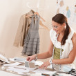 Female fashion designer working with sketches — Stock Photo #4698672