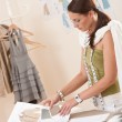 Female fashion designer working with sketches — Stock Photo #4698679