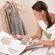 Female fashion designer working with sketches — Stock Photo #4698685