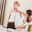 Fashion model fitting clothes by professional designer — Stock Photo
