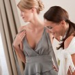 Fashion model fitting gray dress by designer — Stock Photo