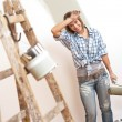 Home improvement: Cheerful woman with paint roller — Stock Photo #4698751