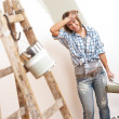 Royalty-Free Stock Photo: Home improvement: Cheerful woman with paint roller