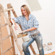 Home improvement: Smiling woman with paint — Stock Photo #4698776