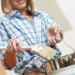 Stock Photo: Home improvement: Smiling womholding paint can
