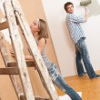 Home improvement: Young couple painting wall — Stock Photo
