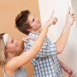Home improvement: Man painting wall with paintbrush — Stock Photo #4698841