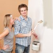 Home improvement: Man painting wall with paintbrush — Stock Photo #4698843