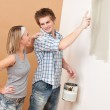 Home improvement: Man painting wall with paintbrush — Stock Photo #4698844