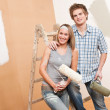 Home improvement: Young couple painting wall — Stockfoto