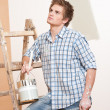 Home improvement: Young man with paint roller — Stock Photo #4698859