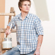 Home improvement: Young man with paint roller — Stock Photo #4698860