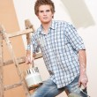 Home improvement: Young man with paint roller — Stock Photo #4698861