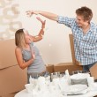 Moving house: Man and woman having fun — Stock Photo