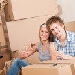 Moving house: Happy man and woman celebrating — Stock Photo #4698975
