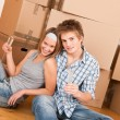 Moving house: Happy man and woman celebrating — Stock Photo #4698983