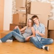 Moving house: Happy man and woman celebrating — Stock Photo