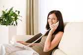 On the phone home: woman calling — Stock Photo