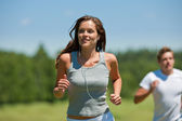 Young couple jogging outdoors in spring nature — Fotografia Stock