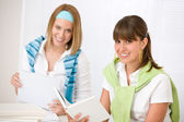 Student at home - two young woman study together — Stock Photo