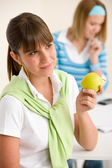 Student at home - happy woman with apple — Stock Photo