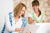 Student at home - two happy woman with laptop — Stock Photo