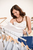 Fashion shopping - Happy young woman choose clothes — Stock Photo