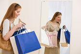 Fashion shopping - Happy woman try on sale clothes — Stock Photo