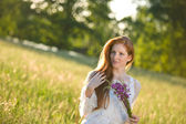 Long red hair woman in romantic sunset meadow — Stock Photo