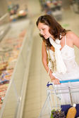 Grocery store - young woman shopping — Stock Photo