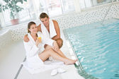 Swimming pool - young happy couple relax — Stock Photo