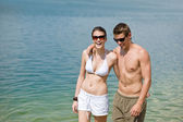 Happy couple in swimwear at sea enjoy sun — Stock Photo