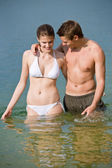 Couple in swimwear enjoy water and sun in summer — Stock Photo