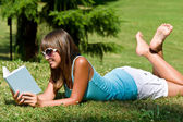 Relax in park - woman with book on sunny day — Stock Photo