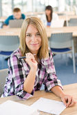 Happy smiling student study in classroom at university — Stock Photo