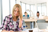 Back to school - female student writing notes — Stock Photo