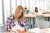 Happy female student with book — Stock Photo