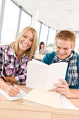 Back to school - happy students with books — Stock Photo