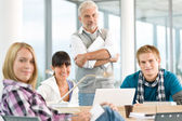 High school - three students with mature professor — Stock Photo