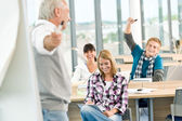 High school - three students with mature professor — Stock Photo