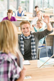 High school student raising hands — Stock Photo