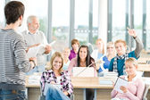 Group of students in classroom — Stockfoto