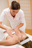 Skincare - woman cleavage massage at salon — Stock Photo