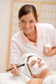 Facial mask - woman at beauty salon — Stock Photo