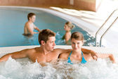 Swimming pool - young couple relax in hot tub — Stock Photo